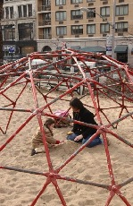 One of the playgrounds has an open geodesic dome